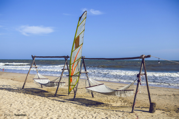 Chairs and hammocks are placed along the shoreline.