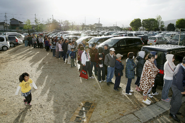 japan-quake-rattles-markets-as-factories-shut-survivors-queue-for-food