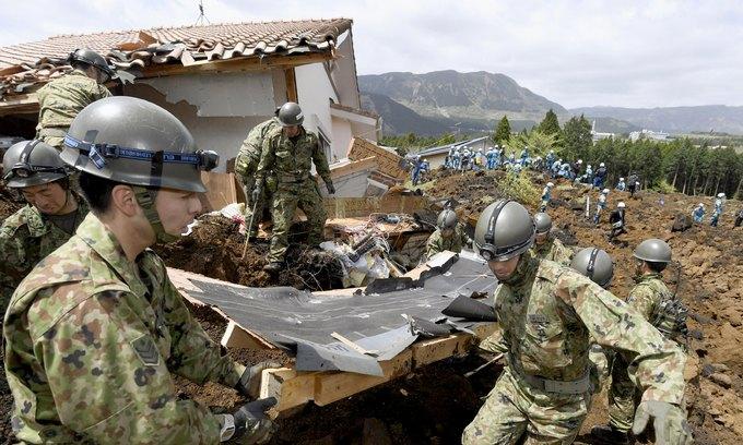 Japan quake rattles markets as factories shut; survivors queue for food