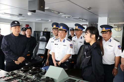 Vietnamese coast guards on board one of the Chinese coast guard ships