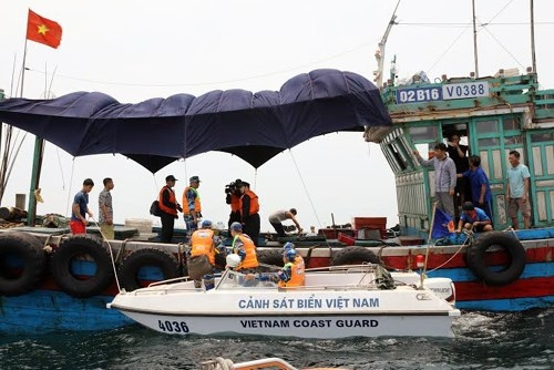 Inspecting a Vietnamese fishing boat