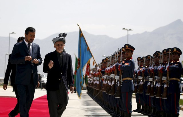 "Afghan president blasts Taliban ""slaves"", but opens door for talks"