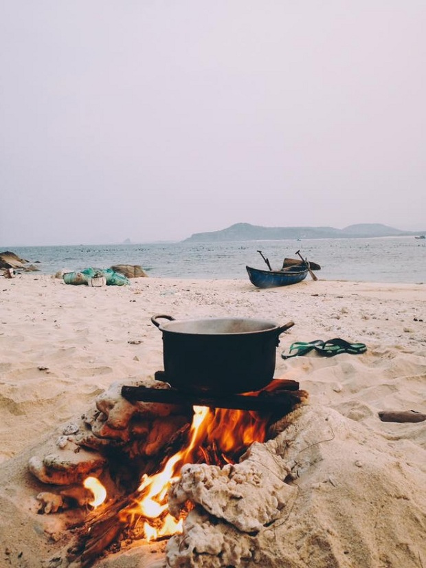 A makeshift stove made right on the beach.