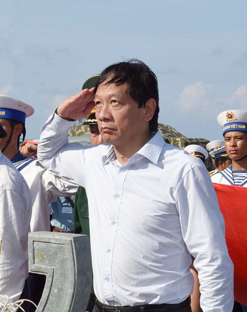 Vo Hong Nam, the General's son, before his fathers statue. My family is deeply touched by the respect of naval officers and soldiers towards the General. This feeling cannot be expressed in words, he said.
