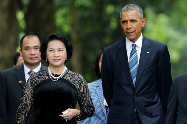 U.S. President Barack Obama walks with Vietnam's National Assembly Chairwoman Nguyen Thi Kim Ngan during a visit at the gardens of the presidential palace in Hanoi, Vietnam May 23, 2016. Photo by Reuters/Carlos Barria