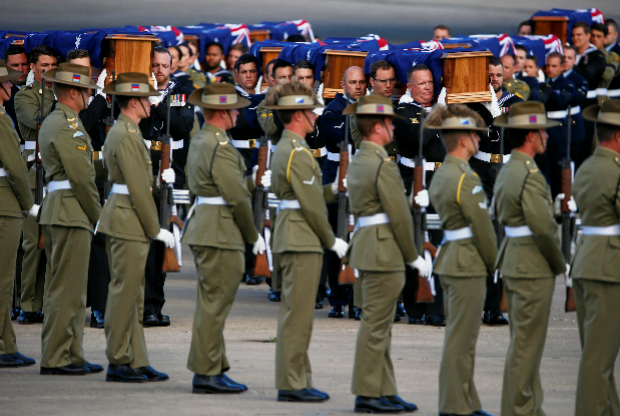 Australian Defence Force personnel carry coffins from a plane that contain the remains of Australian service personnel and dependents, many of whom were casualties of the Vietnam War, during a repatriation ceremony at the Royal Australian Air Force (RAAF) base located in Richmond, west of Sydney, Australia. Photo by Reuters/David Gray