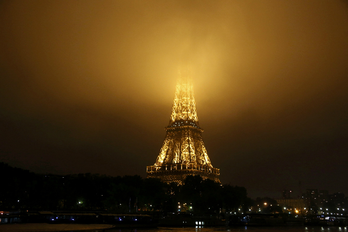 Fog covers the top of the Eiffel Tower as rainy weather continues. Photo by Reuters/Jacky Naegelen