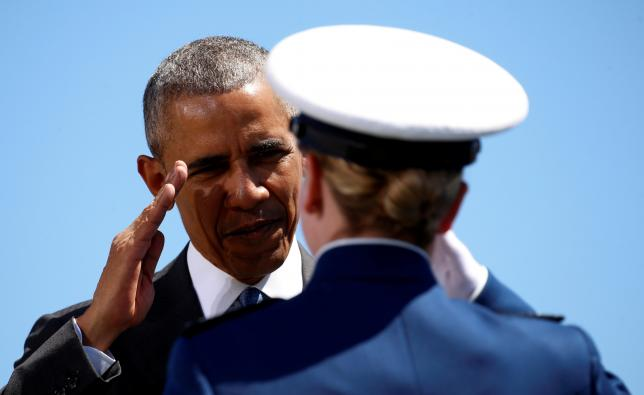 U.S. President Barack Obama salutes a graduate as he participates in the U.S. Air Force Academy commencement ceremony in Colorado Springs, Colorado, U.S., June 2, 2016. Photo by Reuters