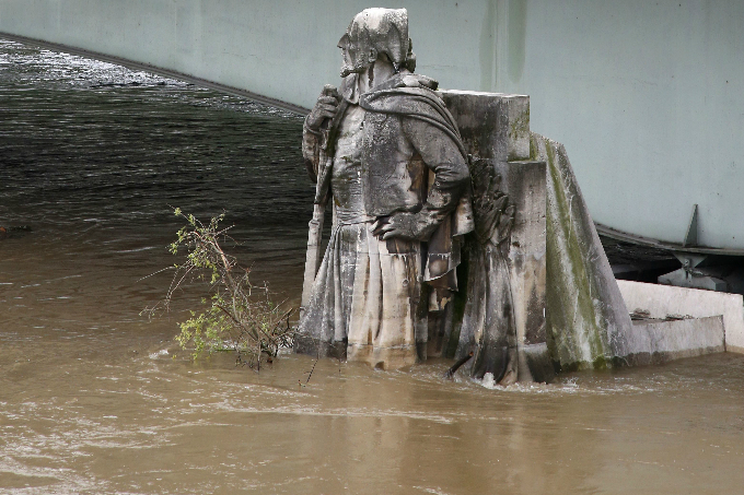 The feet of the Zouave statue on the Pont de l'Alma are covered by the rising waters from the Seine River. Photo by Reuters/Pascal Rossignol