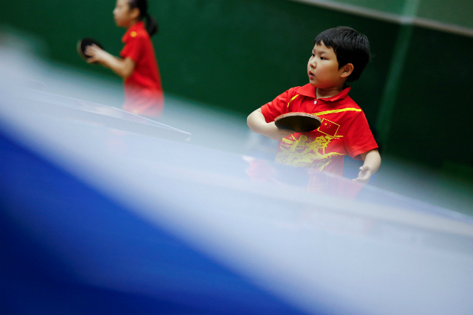 Students practice table tennis at the Shichahai sports school in Beijing. Photo by Reuters/Damir Sagolj