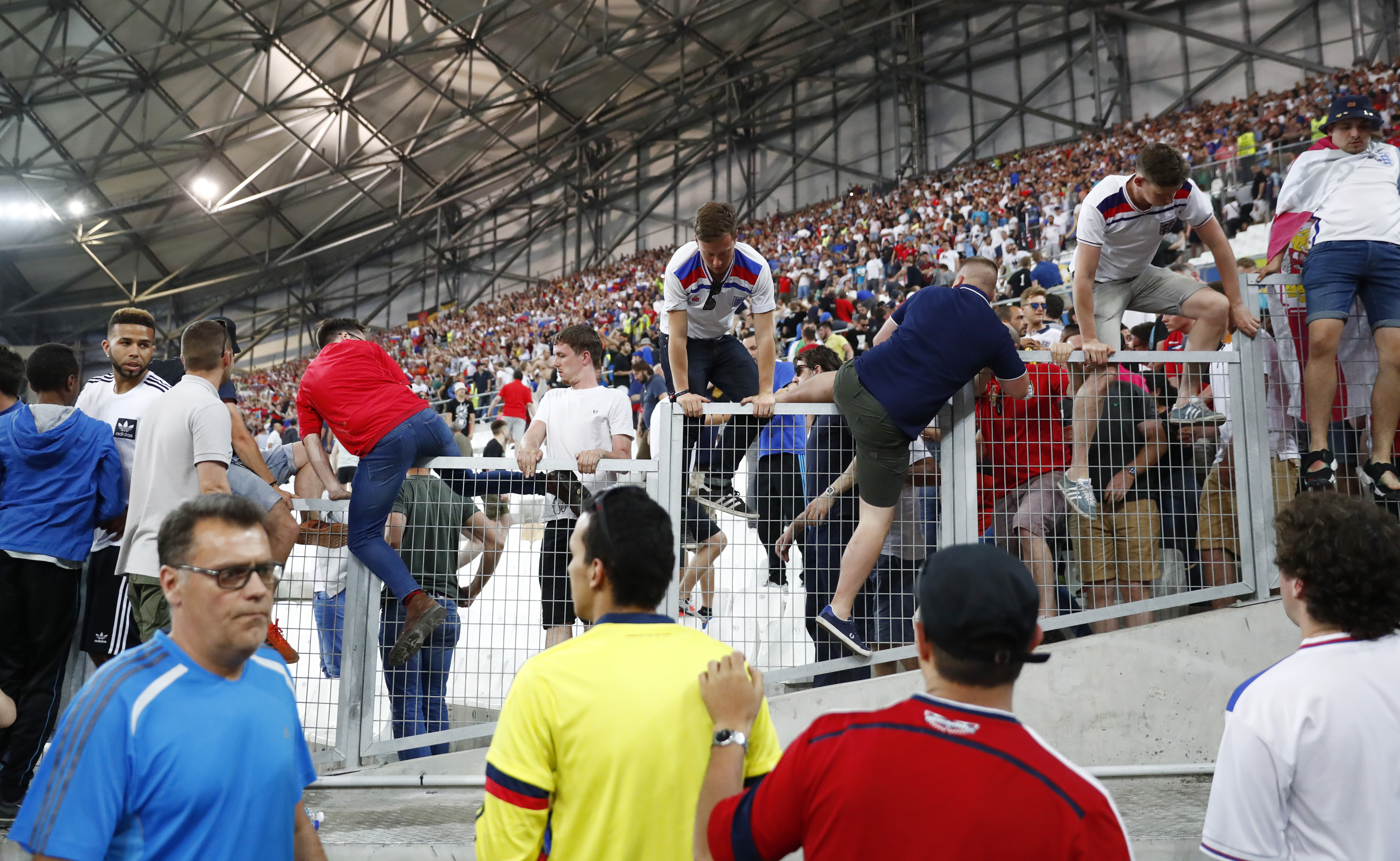Fans clash in the stadium after England v Russia