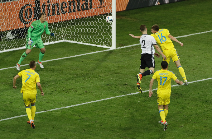 Germany's Shkodran Mustafi scores their first goal. Photo by Reuters/Benoit Tessier Livepic