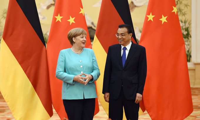 Chinese and German leaders talk on China market status tensions