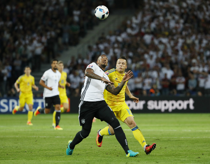 Germany's Jerome Boateng in action with Ukraine's Yevhen Konoplyanka. Photo by Reuters/Gonzalo Fuentes Livepic