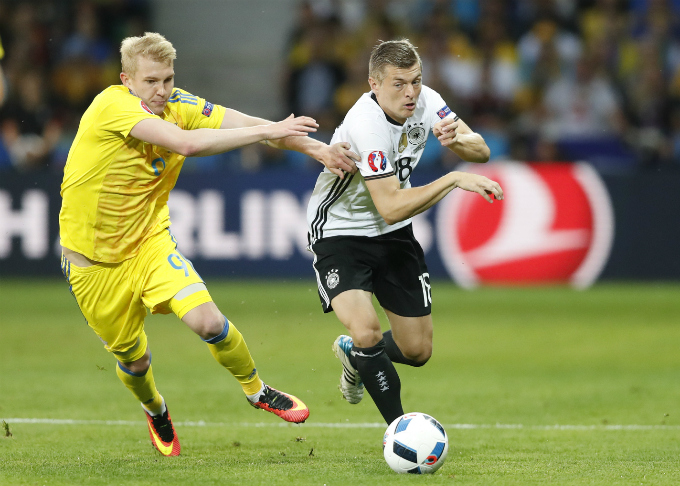 Germany's Toni Kroos and Ukraine's Viktor Kovalenko. Photo by Reuters/Carl Recine Livepic