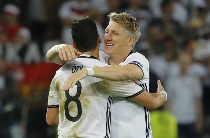 Germany's Bastian Schweinsteiger celebrates with Mesut Ozil after scoring their second goal. Photo by Reuters/Pascal Rossignol Livepic