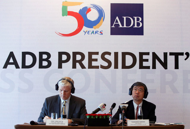 ADB President Takehiko Nakao (R) in the press briefing on June 17. Photo by Reuters/Kham