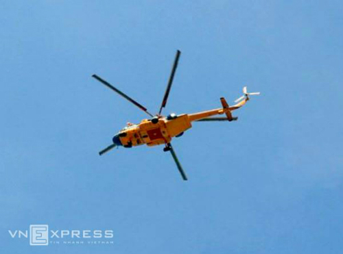 A helicopter during the search. Photo by VnExpress/Hai Binh