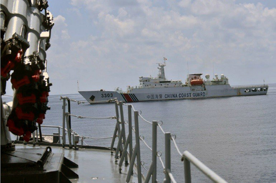 Chinese coast guard ship 3303 passes near Imam Bonjol warship 383 as the Indonesian Navy pursues the Han Tan Cou fishing vessel entering Indonesia's Natuna waters on June 17. The Navy caught the China-flagged boat suspected of illegal fishing in Indonesian waters. Photo by Indonesia's Antara