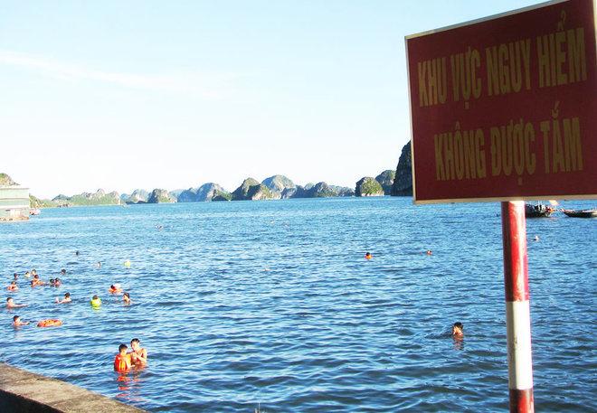 ha-long-locals-risk-dangerous-waters-to-escape-summer-sun