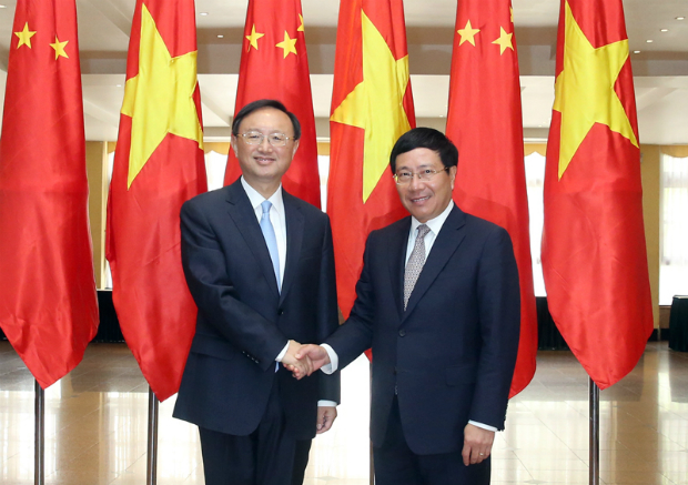 Vietnams Deputy Prime Minister, Foreign Minister Pham Binh Minh (R) and Chinese State Councilor Yang Jiechi (L). Photo by VGP/Hai Minh