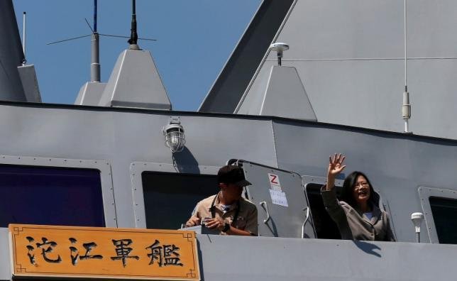 Taiwanese President Tsai Ing-wen waves her hand as she boards the nations first domestically built stealth-missile 500-ton Tuo Jiang twin-hull corvette at Suao Naval Base in Yilan, Taiwan June 4, 2016. Photo by Reuters/Tyrone Siu
