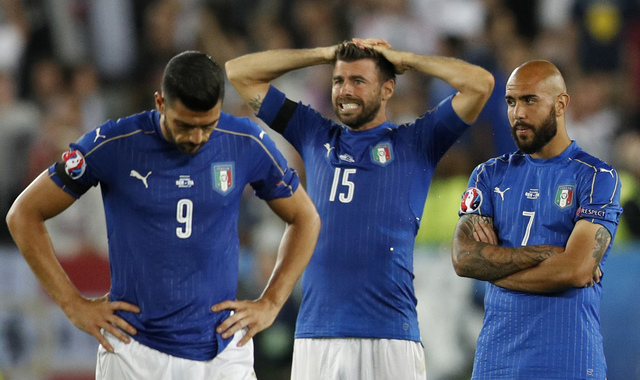 Italys Graziano Pelle, Andrea Barzagli and Simone Zaza react after the penalty shootout. Photo by Reuters/Darren Staples Livepic