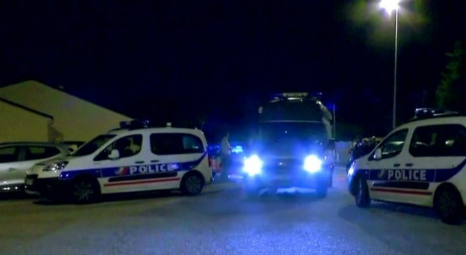 Still image taken from video shows Police vehicles at the scene near where a French police commander was stabbed to death in front of his home in the Paris suburb of Magnanville, France, June 14, 2016. Photo by Reuters
