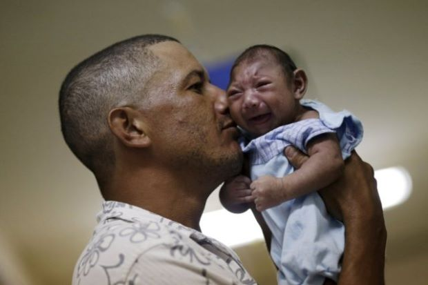 An infected infant. Photo by Reuters