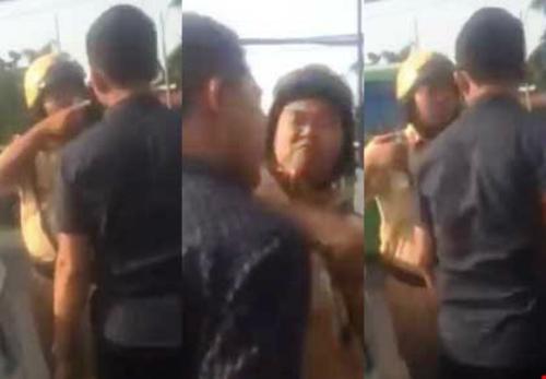 Probe underway after Vietnam cop is filmed assaulting car driver