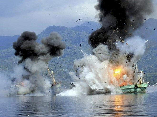 Indonesia sinks foreign boats for illegal fishing in its waters. Photo by Reuters