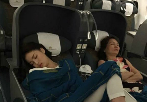 Beauty queen Nguyen Cao Ky Duyen (L) in her infamous sleeping pose deemed inappropriate.