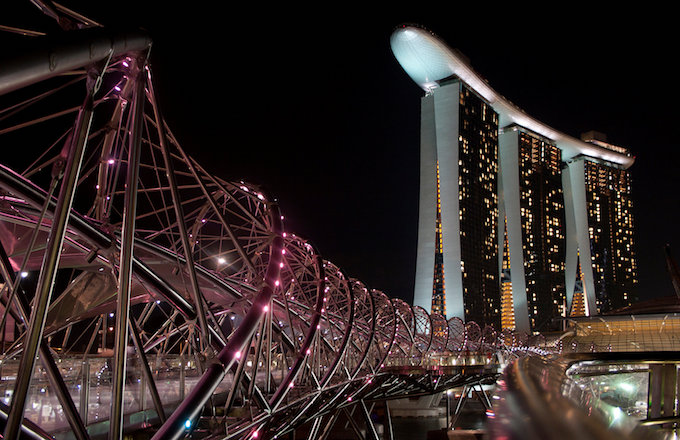 The Helix Bridge (L) is pictured with the Marina Bay Sands resort in the background in Singapore November 1, 2010. Photo by Reuters/Alywin Chew/File Photo