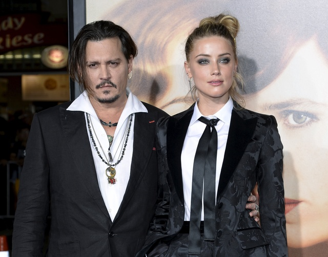 johnny-depp-and-amber-heard-reach-divorce-settlement