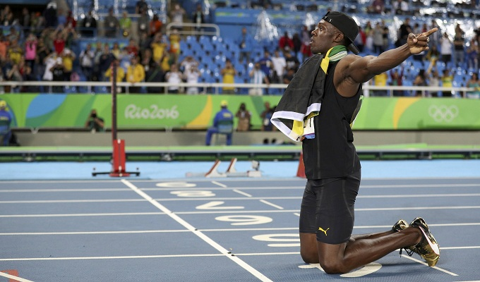 Usain Bolt (JAM) of Jamaica celebrates after his team won the gold. Photo by Reuters/Phil Noble