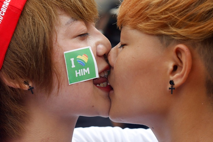 Participants Mo Ngoc (L) and Khanh Bi kiss each other at the 5th annual Viet Pride at American Club in Hanoi. Photo by Reuters/Kham