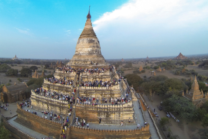 People wait to see the sunset from the top of Shwesandaw Pagoda in the ancient city of Bagan February 13, 2015. Photo by Reuters/Soe Zeya Tun/Files