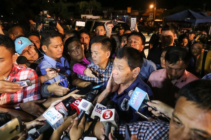Philippine President Rodrigo Duterte speaks to members of the media as he visits the site of an explosion at a nigth market in Davao City in southern island of Mindanao early September 3, 2016. Photo by AFP/Manman Dejeto