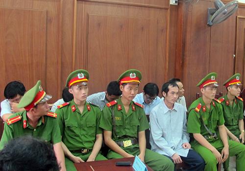 Vietnam court commutes sentences of policemen in brutality case