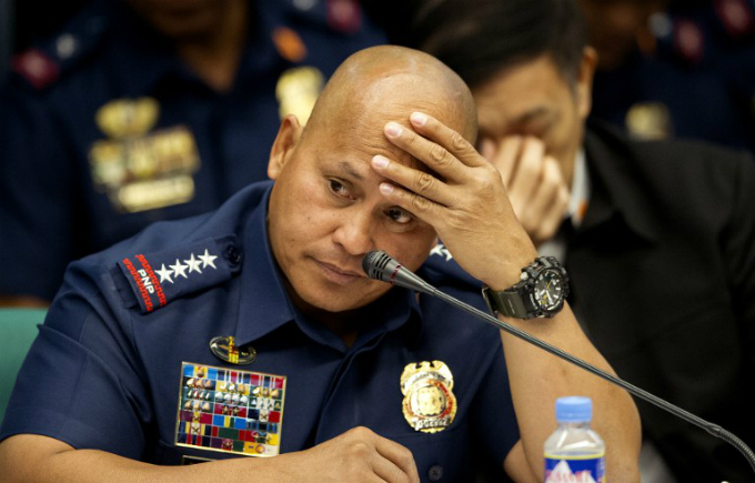 Philippine National Police (PNP) Chief Director Ronald Dela Rosa gestures as he attends a senate hearing in Manila on September 15, 2016. Photo by AFP/Noel Celis