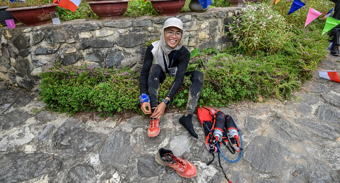 Cao Ha, Vietnamese, first male runner-up of 100km event at the finish line. Photo by Viet Tuan/VMM