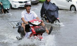 Saigon under threat again as tidal flooding, rains loom