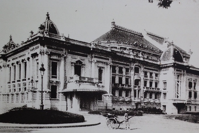 Hanoi Opera House (now 1 Trang Tien Street) in front of August Revolution Square. Built in 10 years (1901-1911) after Palais Garnier, the older of two Pariss opera house, Hanoi Opera House, for the last 100 years, has been the revered stage for many performances.