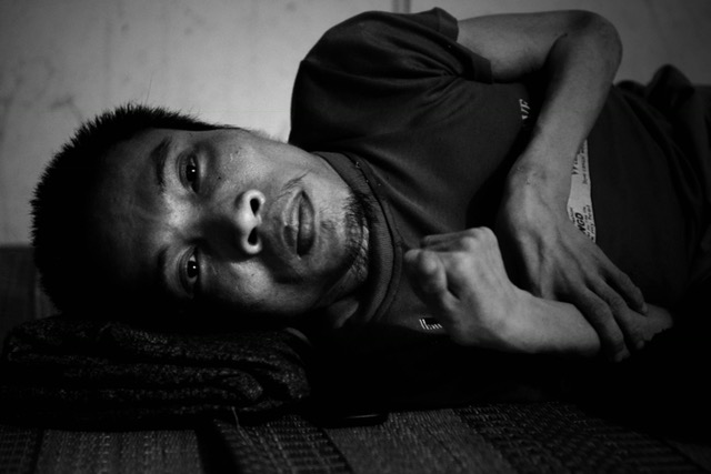 Portrait of Ho Phuoc Hoa, 46, the first son of . Infected by Agent orange