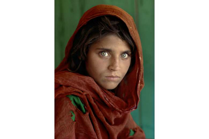 Sharbat Gula, who was featured as a 12-year-old on a celebrated National Geographic magazine cover, has been arrested for living in Pakistan on fraudulent identity papers. Photo by Steve Mccurry