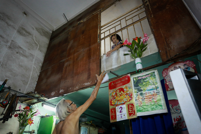 His wife, Nguyen Thi Nhan, 62, often encourages him to continue his job. She sometimes buys painting materials for him.