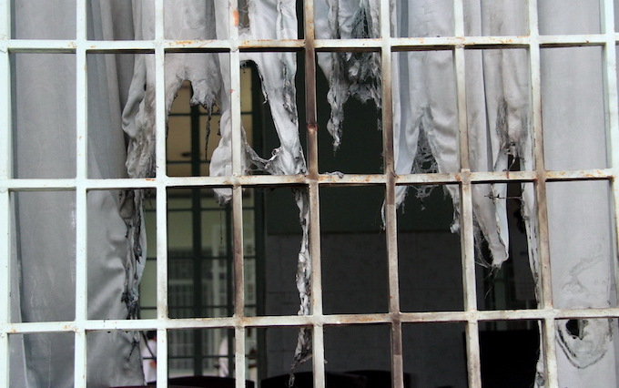 Inmates set curtains in the rehabilitation center to cause chaos and incite others to escape as well, according to the rehabs security staff. Photo by VnExpress/Phuoc Tuan