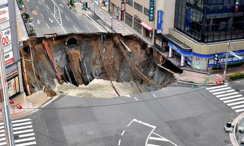 Sink hole swallows Japan road
