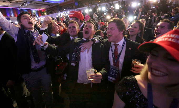 1. Supporters of U.S. Republican presidential nominee Donald Trump react at his election night rally in Manhattan, New York, U.S., November 8, 2016. Photo by Reuters/Carlo Allegri