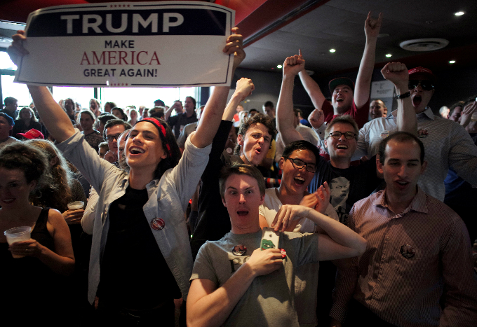 Supporters of U.S Republican Presidential candidate Donald Trump react as a state is called in his favour, as students watch the live results of the U.S. presidential election, at the University of Sydney in Australia, November 9, 2016. Photo by Reuters/Jason Reed